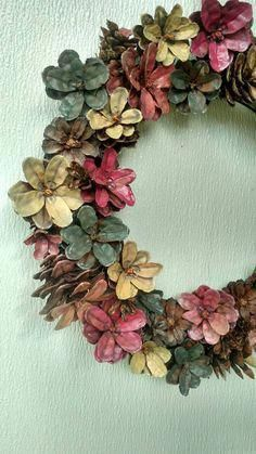 Celebrate the season with the rustic look of these painted pine cone wreaths! Customisable for any season! Available in 12 and youll love this original touch of primitive beauty in your living space! And dont forget the original pine cone wreath in th Pine Cone Art, Pine Cone Crafts, Painting Pine Cones, Christmas Wreaths, Christmas Crafts, Christmas Decorations, Christmas Christmas, Father Christmas, Pine Cone Flower Wreath