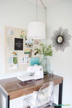 Gorgeous craft room makeover - I love the hanging pendant, the ghost chair and the DIY Inspiratinon Board! via Life On Virginia Street