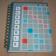 This is a handmade journal, made from part of a Scrabble board game. Both the front and back cover are made from part of the old game board. ♥  The journal contains at least 100 pages (50 sheets) of high quality thick cream paper bound with an antique bronze wire binding. ♥