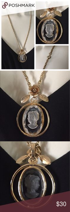 """Vintage Reversed Carved Cameo Necklace Pretty Vintage Reverse Carved clear Lucite Cameo Pendant Necklace in a gold-tone setting and on a double link gold-tone chain. The pendant is topped with a lovely 3-D rose. Chain measures 24""""; Pendant measures 1-3/4"""" to top of bail/ rose x 1-1/4"""" in diameter. In excellent preowned vintage condition. Smoke-free home. Vintage Jewelry Necklaces"""