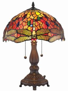 This beautiful table lamp features handcrafted glass created in rich jewel tones. Made with 77 stunning jewels and 343 hand-cut pieces of glass, each wrapped in fine copper foil, this lamp utilizes th Buffet Table Lamps, Table Lamps For Bedroom, Tiffany Style Table Lamps, Tiffany Lamps, Lampe Art Deco, Lamp Shade Store, Stained Glass Lamps, Bedroom Night Stands, Light Table