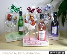 Christmas gifts: wine glasses filled with candy accompanied by a mini bottle of wine