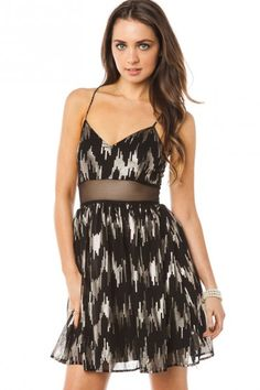 Metallic shine adds sparkle to this cocktail dress.