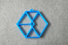This listing is for a 3D printed pendant inspired by EXO. The pendant comes with a metal ring so that you can put it onto any necklace you choose as there is no necklace included with this listing.  Printed in translucent blue PLA filament and measures approximately 2 wide.  This pendant has received no finishing treatments.