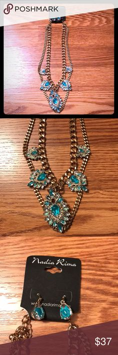 Boutique Statement Necklace Set This Nadia Rima Statement Necklace Set is a brand new Boutique item. The blue and silver stones shine off of the two chained Necklace. Matching fish hook earrings included. The gold toned chain is adjustable to different lengths. Perfect gift this holiday season! Ships same or next day from a smoke free home! Nadia Rima Jewelry Necklaces