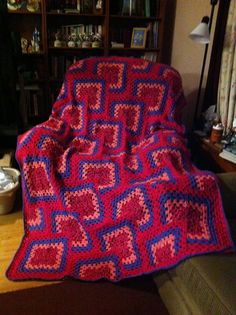 """From fan Tammy Cologie: """"this is hot off my hook! """"tiled Granny Throw"""" Red Heart Free pattern, I made it into an afghan by adding more squares, total of 88 squares!"""" Pattern: http://www.redheart.com/free-patterns/tiles-granny-afghan"""