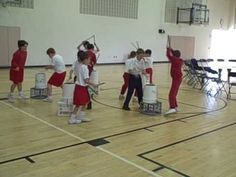 3rd grade bucket drumming. like the addition of movement between drums