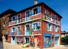 French artist Patrick Kommesi transforms boring buildings into something else