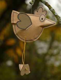 stuffed paper bird eco green craft from an old recycled brown paper bag or store bag cute kids art and craft idea