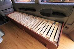 """Sofa bed / pull-out bed in the """"in"""" position for sitting. Tutorial by Carlos Alcos. ~ trailer camper caravan RV motorhome tiny house small space bedroom couch space-saving folding furniture"""