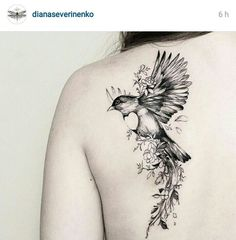 Beautiful bird and flowers tattoo. Would love with a chickadee