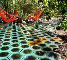 Kismet Tiles and Orange Acapulco Chairs, Remodelista