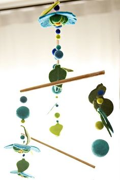 Homemade felt mobile - love the colors. I love copycatchic.