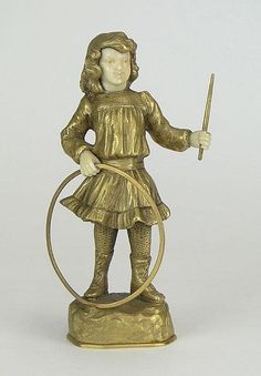 """Georges Omerth French (1895-1925) Bronze Sculpture with Celluloid Face and Hands """"Young Girl with Hoop and Stick"""" Signed Back of Base. Very Good Condition. Measures 6 Inches Tall."""