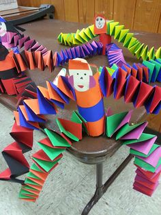 Folded creatures: recycled tubes, construction paper, markers