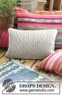 Morgan's Daughter Pillow - Pillow with cables. Piece is knitted in DROPS Flora. Free knitting pattern DROPS 183-34
