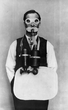 Photograph from the Trench Warfare Section of the Ministry of Munitions showing a man wearing breathing apparatus against gas attack