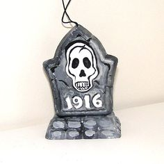 Hey, I found this really awesome Etsy listing at https://www.etsy.com/listing/84297459/halloween-ornament-1916-skull-gravestone