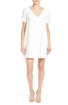 This delicate white shift dress.