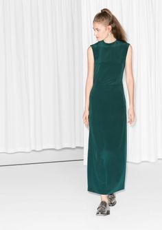 Elegant maxi dress with a skin-exposing back, all made from soft silk.