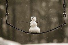 Tiny snowman on a swing