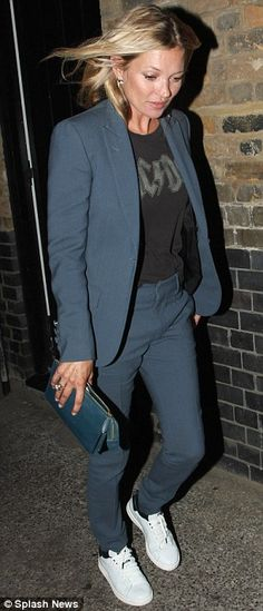 Eyes down: Kate Moss chose a dark blue suit and AC DC Tee (L)...