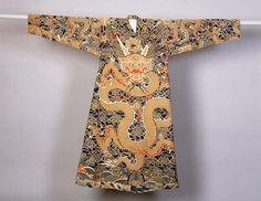 Man's jifu (dragon robe)  Silk tapestry (kesi); gold-wrapped thread  Centimetres: 188 (length), 146 (width)  1675-1700 AD  Late Empire II, Qing Dynasty, Kangxi, 17th century AD  Area of Origin: China