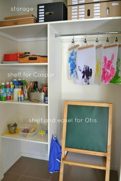I adore a lot about this art space, particularly the hangers for art display and drying. {How we Montessori - Art Centre for multiple ages}