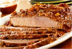 All Day Carolina Beef Brisket is a tangy and tasty recipe for slow cooker brisket. This easy slow cooker brisket recipe is made with salsa, molasses, Worcestershire, onion, and more.
