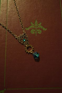 Blue crystal filigree and gear necklace on etsy