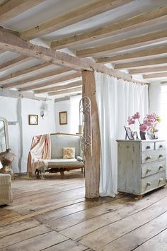 """[i]Linen muslin curtains screen off the dressing area from the bed in the main bedroom.[/i] Like this? Then you'll love [link url=""""http://www.houseandgarden.co.uk/interiors/small-bedrooms""""]Small bedroom ideas[/link]"""