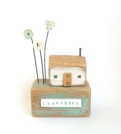 Little wooden loveshack with clay heart and button flowers