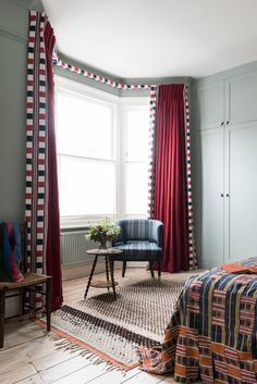 Ideas for hiding a curtain track, if you prefer not to have a traditional pelmet.  Consider a fabric-covered track, particularly in a bedroom bay window because the curtains will sit flush against the wall and block out the light. Design by Kate Guinness