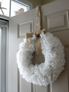 Wreath from plastic shopping bags tied to a wire hanger. (Inspiration!! Brown plastic bags would make a great fall wreath, as well as black ones for Halloween! )