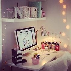 love the idea of the shelf just above the desk and then the lights around it