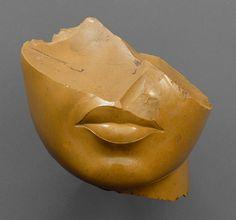 Fragment of the face of a queen, New Kingdom, Amarna Period, Dynasty 18, reign of Akhenaten, ca. 1353–1336 B.C.  Egypt; yellow jasper  (Metropolitan Museum of Art)