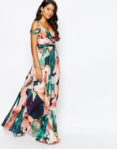 Unique brides who want a wedding that feels different in every aspect should consider floral bridesmaid dresses - how beautiful is this bold tropical pick? (And perfect for a beach wedding!). Click for more of our favorite styles to buy now.
