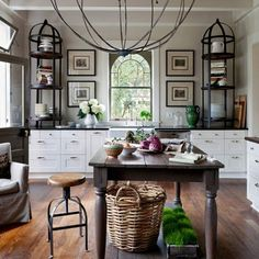 The scale of the chandelier is enough to stop you in your tracks. The mix of French country-inspired and industrial aesthetics is beautifully striking.