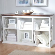 A Hayneedle exclusive, the Belham Living Hampton Console Table 2 Shelf Bookcase - White/Oak offers a clean, crisp style that works.
