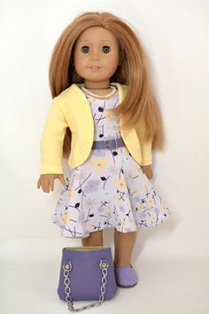 Five Piece Outfit Fits 18 inch Dolls like American Girl Curved sweater Flowered dress with belt Necklace Purse Shoes The curved sweater is made from a soft buttery yellow knit. It has long cuffed sleeves that can be pushed up for a more casual look if desired. The dress is made