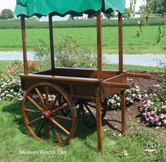 "Peddler's Cart 28"" wood spoke wheels as shown. Size, the box width is approximate 30"" and the length including the handles is 4'"