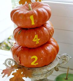 House number on pumpkins.