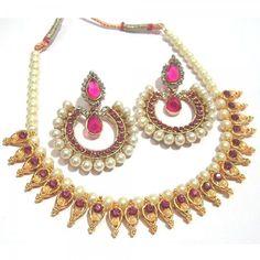 Buy Dark Pink Stone Leaf Tilak Polki Necklace Set Online at cheap prices from Shopkio.com: India`s best online shoping site