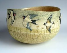 "I adore this!  From the page:""If you like your ceramics quirky with wildlife on them you cannot get better than Anna Lambert. Anna is an English ceramacist living in Yorkshire who has work in many galleries and craft shops. She has a huge display of her work here at the Junction Workshop."""