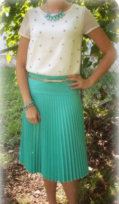 .so pretty. teal and white with gold polka dots. wear to work; church.