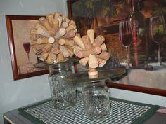 wine cork balls setting on top of mason jar cake plates....corks hot glued to styrofoam balls...candle plates glued to mason jars using 527 glue.