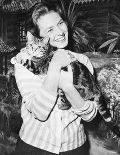 Ingrid Bergman cuddling with her tabby cat.