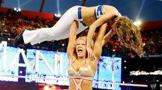 Divas Champion Beth Phoenix lifts EXTRA host Maria Menounos.