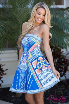 All of a sudden there was a gorgeous print dress - we're sure you'll fall in love with it! It features a bold aztec style pattern in blue, purple, lime green, white, and peach that will stand out in a crowd! It also has a trendy strapless style, a low-cut back with a zipper, an elastic waistband, and is made of a sleek material!