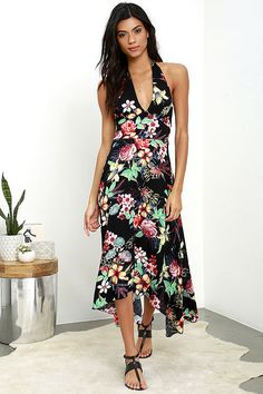 A vacation-ready print and romantic silhouette join to create the Lucy Love Dragonfly Black Floral Print Midi Dress! Tying halter straps top a princess-seamed bodice, with a set-in waist, and smocked back. Black, red, yellow, green, and blue woven, floral print fabric flows to a midi, handkerchief hem.